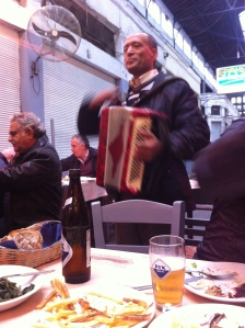 An accordion player at lunch