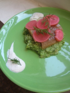 Pea purée with smoked herring and pickled radishes