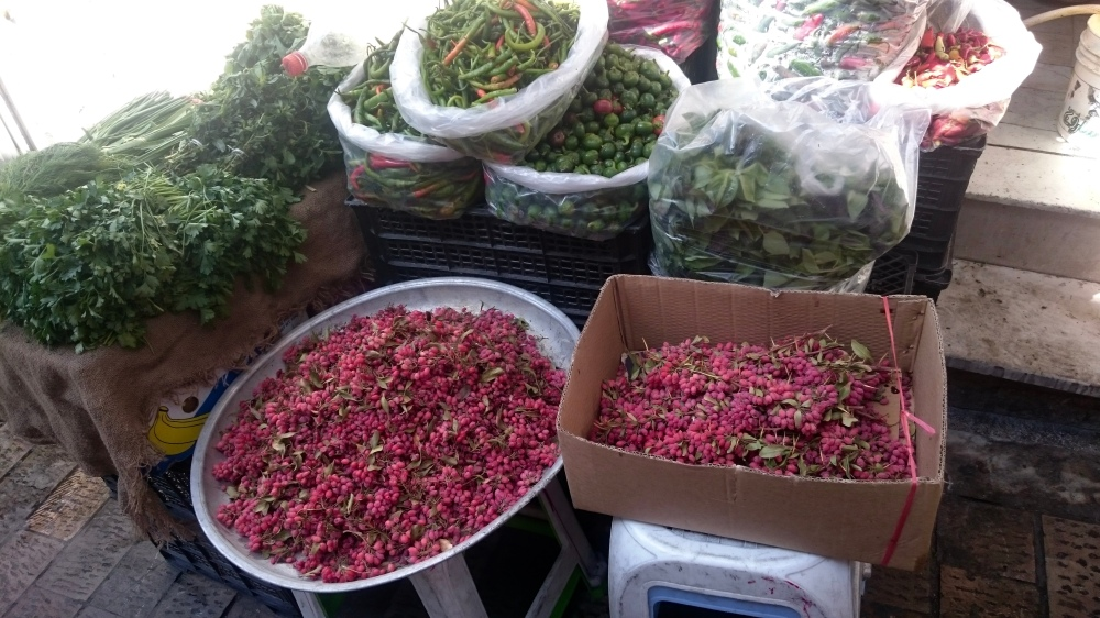 Fresh barberries, herbs, and chilis at Tajrish market, Tehran