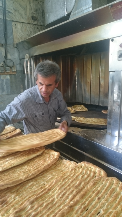 Naan-e-barberi baker in Tajrish market, Tehran